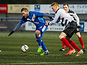 Montrose's Garry Wood is pulled back by Shire's David Bates.