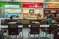 Yogyakarta, Java, Indonesia.  Ambarrukmo Shopping Mall, Restaurants in the Food Court.