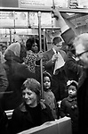 London underground tube train 1970.Black children and mother