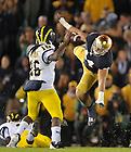 Sep 22, 2012; Michigan Wolverines quarterback Denard Robinson is pressured by linebacker Carlo Calabrese...Photo by Matt Cashore