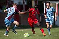 Mo Ceesay of Flackwell Heath takes on Ashley Bird (15) of Tuffley Rovers during the UHLSport Hellenic Premier League match between Flackwell Heath v Tuffley Rovers at Wilks Park, Flackwell Heath, England on 20 April 2019. Photo by Andy Rowland.