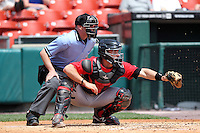 Indianapolis Indians catcher Eric Fryer #50 and umpire Jon Byrne during a game against the Buffalo Bisons at Coca-Cola Field on May 22, 2012 in Buffalo, New York.  Indianapolis defeated Buffalo 6-3.  (Mike Janes/Four Seam Images)