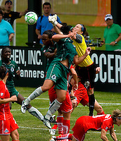 Washington Freedom goalkeeper Erin McLeod (18) knocks the ball away during a WPS match at Anheuser-Busch Soccer Park, in Fenton, MO, June 20 2009. Washington  won the match 1-0.
