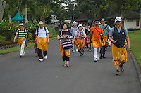 Borobudur, Java, Indonesia.  Japanese Tourists Returning to the Manohara Hotel after Visiting Borobudur Temple.  All visitors are asked to wear sarongs before entering the temple grounds.