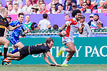 Bastian Himmer of Germany (L) tries to tackle Siosifa Lisala of Japan (R) during the HSBC World Rugby Sevens Series Qualifier Final match between Germany and Japan as part of the HSBC Hong Kong Sevens 2018 on 08 April 2018 in Hong Kong, Hong Kong. Photo by Marcio Rodrigo Machado / Power Sport Images