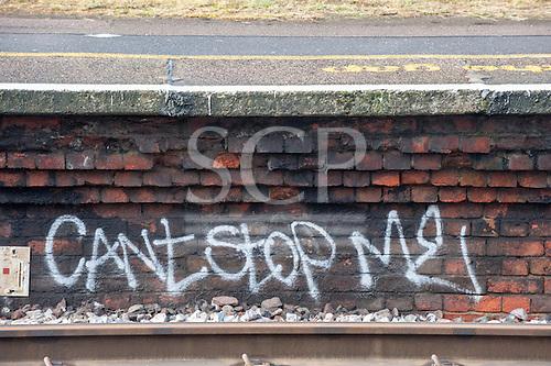 "Norbiton station, Surrey. Graffitti ""Can't stop me"" under the platform."