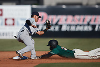 Eduardo Torrealba (9) of the Hudson Valley Renegades fields a throw as Lolo Sanchez (34) of the Greensboro Grasshoppers steals second base at First National Bank Field on September 2, 2021 in Greensboro, North Carolina. (Brian Westerholt/Four Seam Images)