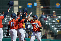 BrandenComia (23) of the Illinois Fighting Illini is congratulated by his teammates after hitting a two-run home run against the West Virginia Mountaineers at TicketReturn.com Field at Pelicans Ballpark on February 23, 2020 in Myrtle Beach, South Carolina. The Fighting Illini defeated the Mountaineers 2-1.  (Brian Westerholt/Four Seam Images)