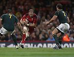 Wales lock Alun Wyn Jones takes on Springbok pair Willem Alberts and Bismarck Du Plessis.<br /> <br /> 2013 Dove Men Series<br /> Wales v South Africa<br /> Millennium Stadium<br /> 09.11.13<br /> ©Steve Pope-Sportingwales