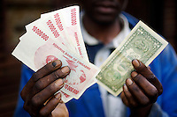 The official inflation rate reached 100,000% in March 2008, with one US dollar equal to 40 million Zimbabwean dollars on the black market...