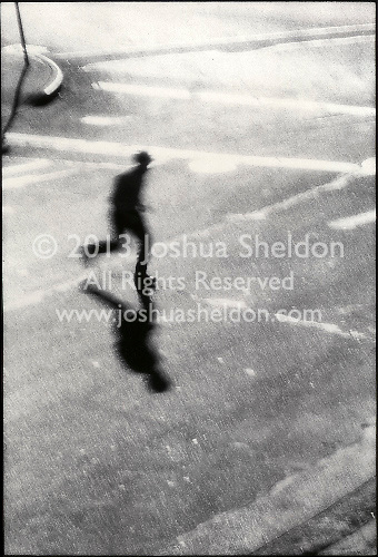 Silhouetted man running