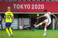 TOKYO, JAPAN - JULY 21: Christen Press #11 of the United States shoots during a game between Sweden and USWNT at Tokyo Stadium on July 21, 2021 in Tokyo, Japan.