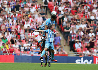 28th May 2018, Wembley Stadium, London, England;  EFL League 2 football, playoff final, Coventry City versus Exeter City; Maxime Biamou of Coventry City jumps above Marc McNulty of Coventry City and Craig Woodman of Exeter City to head the ball out