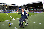 Gordon Reid takes the applause of the crowd at half-time as he comes home with his trophy for winning the Australian Open Wheelchair Singles tennis title.