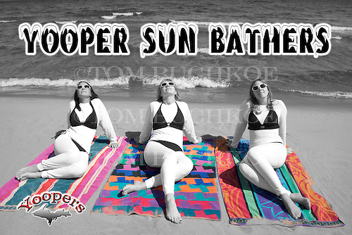 Yoopers know that the harsh summer sun can really burn their tender pale bodies. A good sunblock can save the day. These cuties are using SPF 1000.