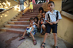 A group of children pose for a snapshot outside the Jade Emperor Pagoda in Ho Chi Minh City, Vietnam. July 3, 2011.