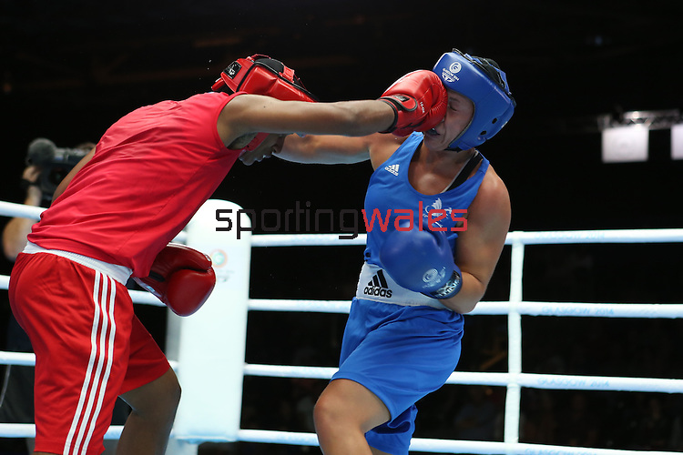 Glasgow 2014 Commonwealth Games<br /> Charlene Jones, Wales (Blue) v Hansika Arachchi, Sri Lanka (Red)<br /> Women's Light (57-60kg)<br /> SECC<br /> 29.07.14<br /> ©Steve Pope-SPORTINGWALES