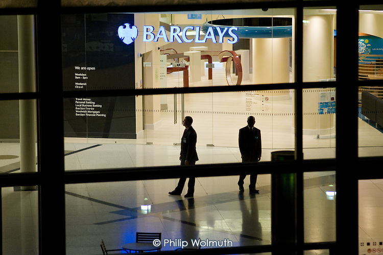 Security guards on a night shift at Barclays headquarters in Canary Wharf, London Docklands. Barclays is the only City bank to have agreed to pay its staff no less than the London Living Wage, currently £7.60 an hour.  The National Minimum Wage is £5.73.