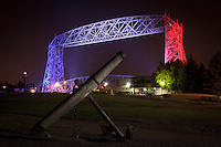 An anchor in Canal Park is framed by the patriotically-lit Aerial Lift Bridge for the Independence Day celebrations.<br />