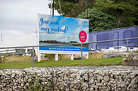 BNPS.co.uk (01202) 558833. <br /> Pic: BNPS<br /> <br /> Pictured: A Rockley Park sign by the beach at at Rockley Point in Poole Harbour, Dorset. <br /> <br /> A grieving mother who complained to a caravan park about the lack of safety measures at a beach where her son drowned has been offered a free holiday in response.<br /> <br /> Callum Osborne-Ward, 18, was swept away in front of his family moments after rescuing several children from a deadly riptide at Rockley Point in Poole Harbour, Dorset, last month.<br /> <br /> His devastated mother Ann Marie Osborne has since criticised holiday firm Haven, which owns the caravan park backing onto the waterway, for failing to warn visitors about the hidden riptide and advertising the beach on its website.