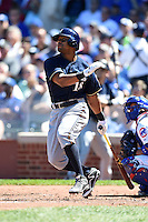 Milwaukee Brewers outfielder Khris Davis (18) at bat during a game against the Chicago Cubs on August 14, 2014 at Wrigley Field in Chicago, Illinois.  Milwaukee defeated Chicago 6-2.  (Mike Janes/Four Seam Images)