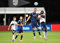 LAKE BUENA VISTA, FL - JULY 26: Roger Espinoza of Sporting KC and Leonard Owusu of Vancouver Whitecaps FC challenge for a header during a game between Vancouver Whitecaps and Sporting Kansas City at ESPN Wide World of Sports on July 26, 2020 in Lake Buena Vista, Florida.
