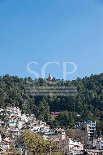 Shimla, Himachal Pradesh, India. Looking eastwards over the town with the Hanuman statue in the distance.
