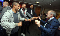 Pictured L-R: Players Wayne Routledge, Ashley Williams and Kyle Bartley are entertained by a magician <br /> Re: Swansea City FC Christmas party at the Liberty Stadium, south Wales, UK.
