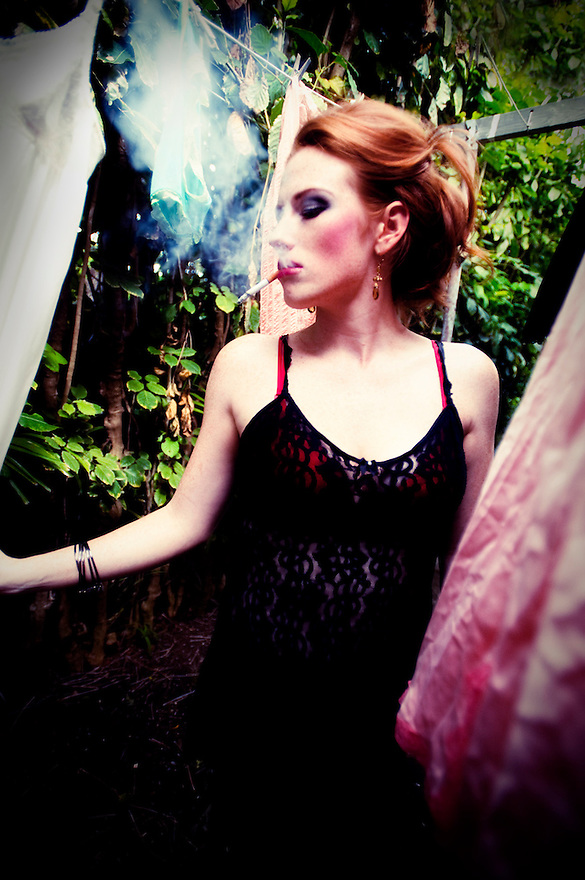 Fashion Photography by Liisa Roberts. Laundry Day. Red head smoking cigarette while hanging underwear.  Thrift Store Fashion finds.  Vintage wear. Reduce, Reuse, Recycle, ReFashion