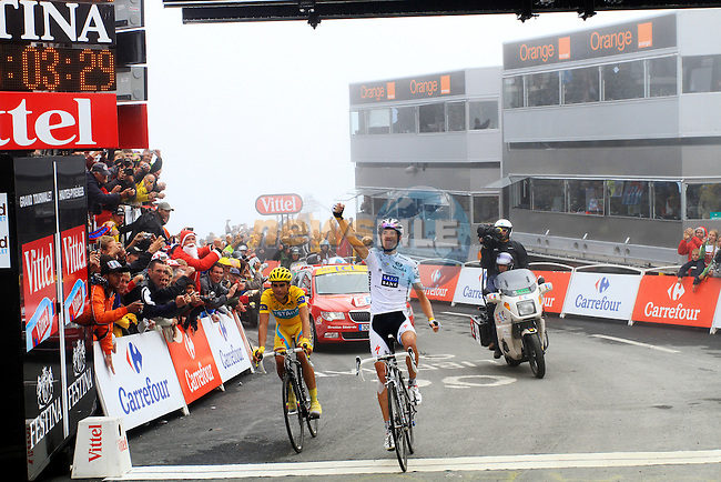 Andy Schleck (Saxo Bank) crosses the line, with Yellow Jersey leader Alberto Contador (Astana) behind at the finish summit of the Col du Tourmalet to win a wet foggy Stage 17 of the 2010 Tour de France at Palais Beaumont from Pau to Col du Tourmalet, 22nd July 2010 (Photo by Steven Franzoni/NEWSFILE)