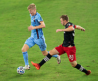 WASHINGTON, DC - SEPTEMBER 06: Keaton Parks #55 of New York City FC dribbles past Julian Gressel #31 of D.C. United during a game between New York City FC and D.C. United at Audi Field on September 06, 2020 in Washington, DC.