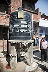 12 March 2013, Kanpur, Uttar Pradesh India: A community water tank stands in the courtyard of a small colony. The President of the World Bank, Mr Jim Yong Kim visited the low income suburb of Gwaltoli  on his tour of Kanpur in Uttar Pradesh state, India. Mr.Kim is visiting India  for meetings with local staff, Indian Government Ministers and to inspect projects sponsored by World Bank in regional areas. Picture by Graham Crouch/World Bank