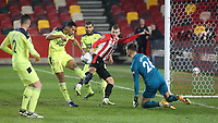 Newcastle's Isaac Hayden clears the ball under pressure from Brentford's Marcus Forss during Brentford vs Newcastle United, Carabao Cup Football at the Brentford Community Stadium on 22nd December 2020