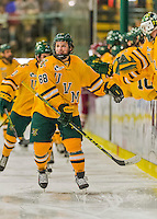 19 February 2016: University of Vermont Catamount Forward Jonathan Turk, a Senior from Calgary, Alberta, skates by his bench to celebrate his opening goal of the game with only 15 seconds into the first period against the Boston College Eagles at Gutterson Fieldhouse in Burlington, Vermont. The Eagles defeated the Catamounts 3-1 in the first game of their weekend series. Mandatory Credit: Ed Wolfstein Photo *** RAW (NEF) Image File Available ***