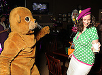 """Cynthia Conner,at right, dances with the gopher,aka Jenni Rebecca Stephenson at the """"Be the Ball"""" annual benefit holiday bash supporting Glasstire and Fresh Arts Coalition at the Herman Park Golf Course Friday Jan. 22,2010.(Dave Rossman/For the Chronicle)"""