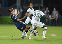 LAKE BUENA VISTA, FL - AUGUST 01: Jesús Medina #19 of New York City FC is tripped by Larrys Mabiala #33 of the Portland Timbers during a game between Portland Timbers and New York City FC at ESPN Wide World of Sports on August 01, 2020 in Lake Buena Vista, Florida.