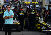 Jul, 20, 2012; Morrison, CO, USA: NHRA team owner Forrest Lucas (left) as his son,  top fuel dragster driver Morgan Lucas prepares to race during qualifying for the Mile High Nationals at Bandimere Speedway. Mandatory Credit: Mark J. Rebilas-US PRESSWIRE
