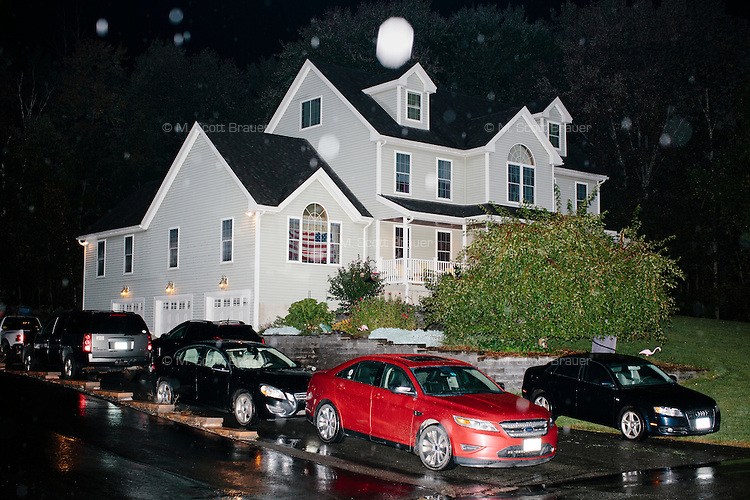 """Rain falls on a house where Texas senator and Republican presidential candidate Ted Cruz will speak at an event called """"Smoke a cigar with Ted Cruz"""" at a house party at the home of Linda & Steven Goddu Salem, New Hampshire."""
