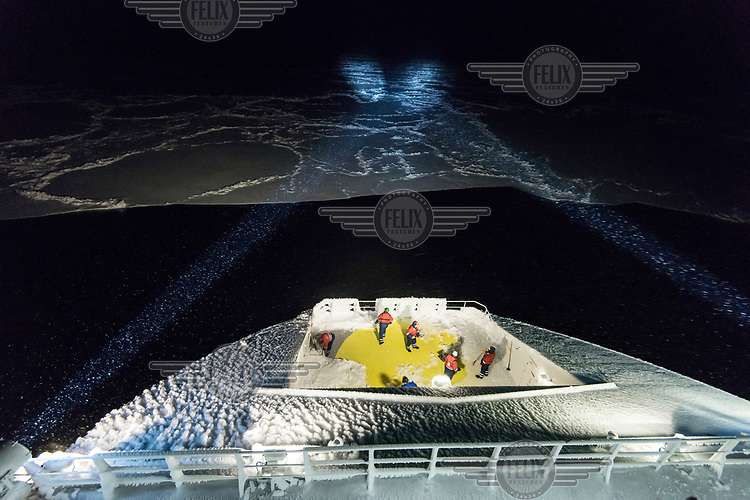 Deck crew clear ice from the exterior of the icebreaker and supply ship the 'Fedor Ushakov' as it makes its way through the Barents Sea along the Northern Sea Route.<br /><br /> Modern technologies incorporated into the vessel make it environmentally friendly. Among them are purification systems for bilge water and ballast waters. It has a desalination system that provides drinkable water. The vessel uses fuel with a very low sulfur content and has a purification system for its exhaust gases.