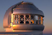 Gemini Northern 8-meter telescope, Mauna Kea Observatory seen at sunset.  The telescope enclosure has large wind vents to help keep the interior temperature close to the exterior temperature.