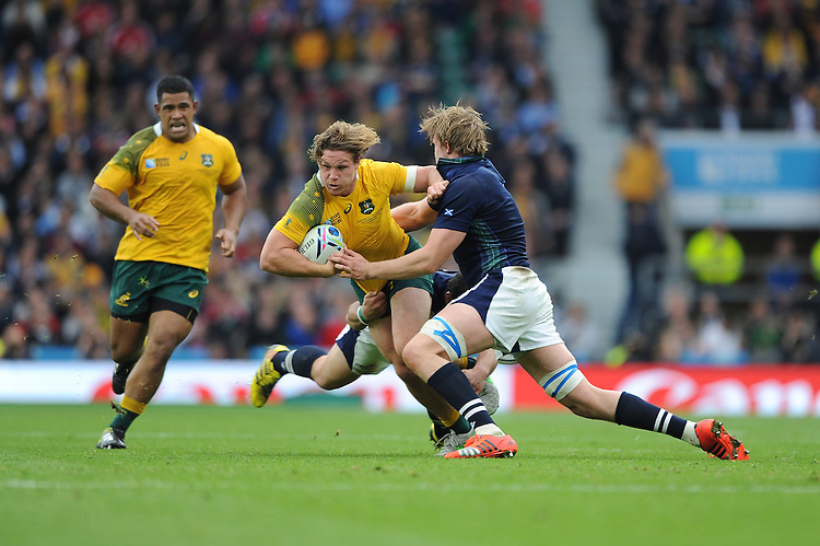 Try scorer Michael Hooper of Australia is tackled by Jonny Gray of Scotland during the Quarter Final of the Rugby World Cup 2015 between Australia and Scotland - 18/10/2015 - Twickenham Stadium, London<br /> Mandatory Credit: Rob Munro/Stewart Communications