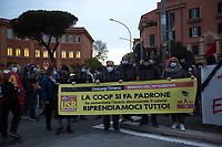 """Rome, 12/12/2020. Today, Movements, Citizens, Social Centers, Associations, Antifascists, state school and university Students, Housing Rights Groups, led by the Trade Union USB, held a protest (1.) which started from Garbatella District to end outside the Lazio Region HQ to urgently call the Local Institutions and the Italian Government to do more and quickly to support the workers in this """"second wave"""" of the pandemic Covid-19/Coronavirus, to create a National Basic Income, to make a """"patrimoniale"""" (wealth tax), to make a """"Webtax"""" for the Internet's giants corporations, to stop the rent of houses and shops and the universities' taxes, to increase investments in the SSN (Italian National Health Service), to stop evictions. Protesters call the Government and the President of the Lazio Region, Nicola Zingaretti (also leader of the Democratic Party PD), to give a structural answer to longstanding problems linked to austerity and precarious work, such as invisibility, poverty, black markets, """"caporalato"""" (illegal hiring), housing crisis, social and economic exclusion and exploitation."""