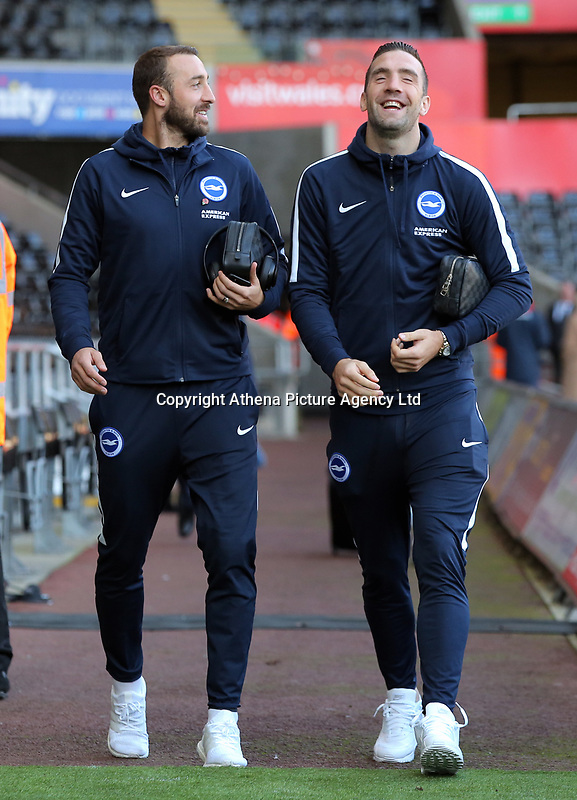 (L-R) Glenn Murray and Shane Duffy of Brighton arrive prior to the game during the Premier League match between Swansea City and Brighton and Hove Albion at The Liberty Stadium, Swansea, Wales, UK. Saturday 04 November 2017