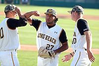 Chris Mathewson (27) of the Long Beach State Dirtbags is greeted by teammates Zach Cerbo (30) and Todd Reagan (40) during a game against the Arizona State Sun Devils at Blair Field on February 27, 2016 in Long Beach, California. Long Beach State defeated Arizona State, 5-2. (Larry Goren/Four Seam Images)