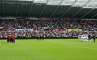 Manchester United, Swansea players and match officials applaud in tribute to honorary president of Swansea Gwilym Joseph before the English Premier League soccer match between Swansea City and Manchester United at Liberty Stadium, Swansea, Wales, UK. Saturday 18 August 2017