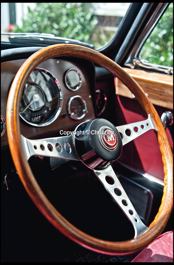 BNPS.co.uk (01202 558833)<br /> Pic: Christies/BNPS<br /> <br /> **Please use full byline**<br /> <br /> Thre steering wheel of the rare Radford Mini De Ville.<br /> <br /> The Rolls Royce... of Mini.<br /> <br /> <br /> An incredibly rare 50-year-old Mini car that was the most luxurious ever made has gone on the market with a whopping 50,000 pounds price tag.<br /> <br /> The pint-sized motor was fitted out with so many deluxe features when it was made in 1964 that it has been described as a Rolls Royce in a Mini's body.<br /> <br /> It boasts a host of innovations and indulgences more common in lavish cars like Rolls Royces and Aston Martins.<br /> <br /> These include electric windows, wooden trim, leather seats, full length sun-roof and deep-pile carpets made from lamb's wool.<br /> <br /> This particular Mini was lovingly restored in the 1990s for Beatles guitarist George Harrison but he passed away from cancer before the work was completed.<br /> <br /> It is tipped to fetch 50,000 pounds when it goes under the hammer at London auction house Christie's on September 3.