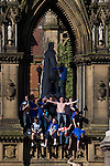 Rangers Fans in Manchester, 14/05/2008. Albert Square, UEFA Cup Final. Fans of Glasgow Rangers climbing on a statue in the centre of Manchester prior to watching the UEFA Cup final against Zenit St. Petersburg on a large screen in Albert Square, the location of one of the UEFA Fan Zones. The match was staged at the City of Manchester Stadium and was won by the Russian team by two goals to nil. It was Rangers' first European final appearance since they won the Cup-Winners Cup in 1972 and around 150,000 fans gathered in Manchester. Photo by Colin McPherson.