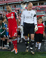 Seattle Sounders FC goalkeeper Kasey Keller #18 and Toronto FC forward Maicon Santos #29 take to the pitch during the opening ceremonies in an MLS game between the Seattle Sounders FC and the Toronto FC at BMO Field in Toronto on June 18, 2011..The Seattle Sounders FC won 1-0.