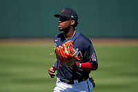 Atlanta Braves outfielder Ronald Acuña Jr. (13) jogs to the dugout during a Major League Spring Training game against the Boston Red Sox on March 7, 2021 at CoolToday Park in North Port, Florida.  (Mike Janes/Four Seam Images)