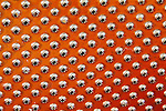 Creative orange abstract of small cheese grater holes